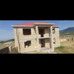 Oguz rayonunda ikimertebeli yaritikili heyet evimi satiram
