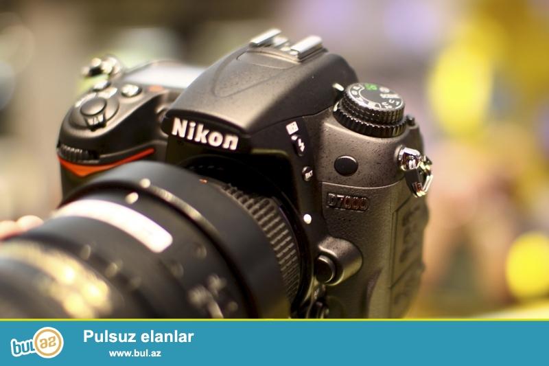 Nikon D7000 18-105 DX Nikkor Lens <br /> -Nikon MB-D11 original battery grip <br /> -Universal tripod <br /> -Sumka <br /> -Obyektiv çexolu, adapter, çiyin kəməri, pult, 8gb kart, blenda, batareyka<br /> -Öz karobkası (Box) <br /> <br /> 900 manat <br /> <br /> 051 5607319