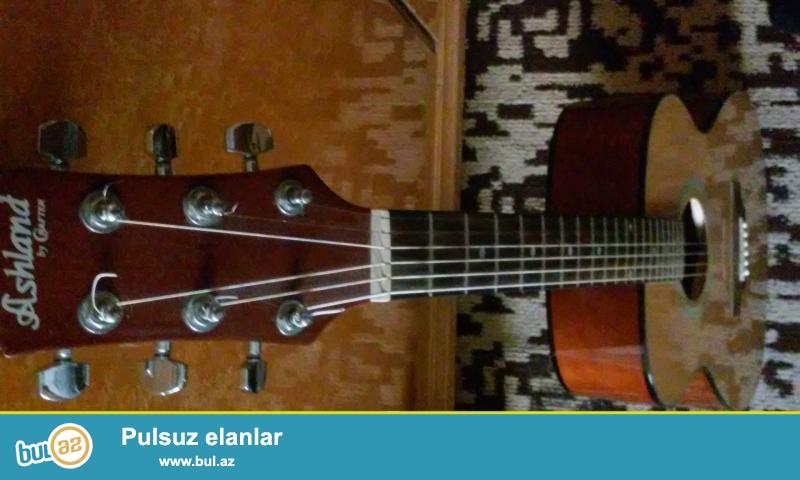 """Akustik gitara """"Ashland by Crafter"""" satilir ustunde teze simleri inen ve cexoluynan..."""