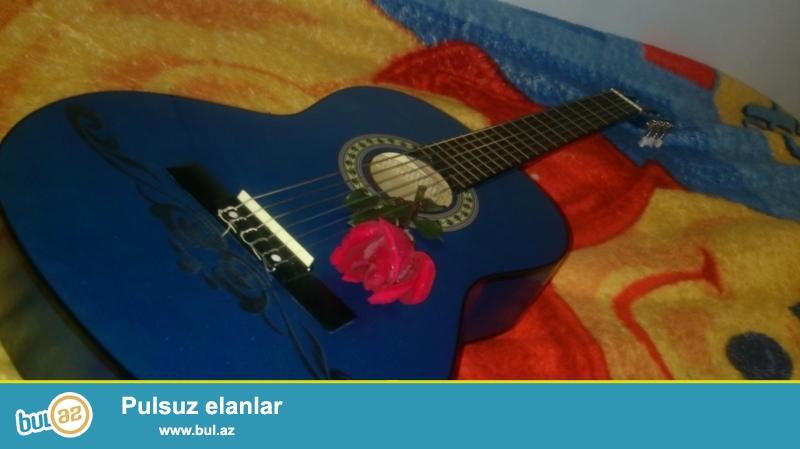 65 azn -Tecili Gitar Satilir !!!<br /> Aciq Mavi rengde 1 ay ishlenmish classic gitar satilir...