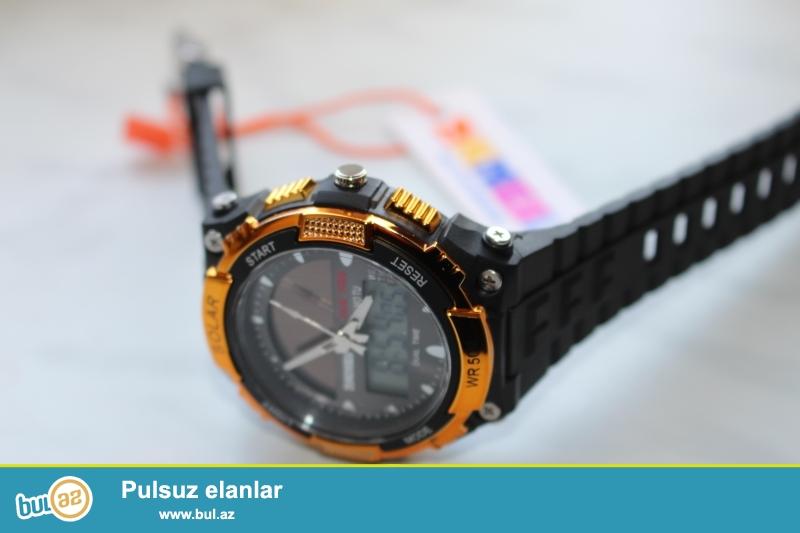 gunes enerjisi ile isleyen saat, tezedir,problemi yoxdur ,hem eqrebli saati ,hem de elektron saati var ve saniye olcen...
