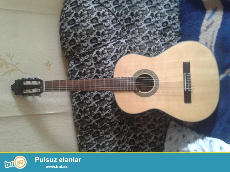 kokleyen aparatla birlikde gitara satilir. az istifade olunub...
