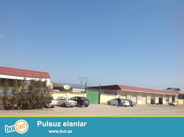 Xaçmaz şəhəri ZBünyadov küçəsində ərazisi 65 sot...