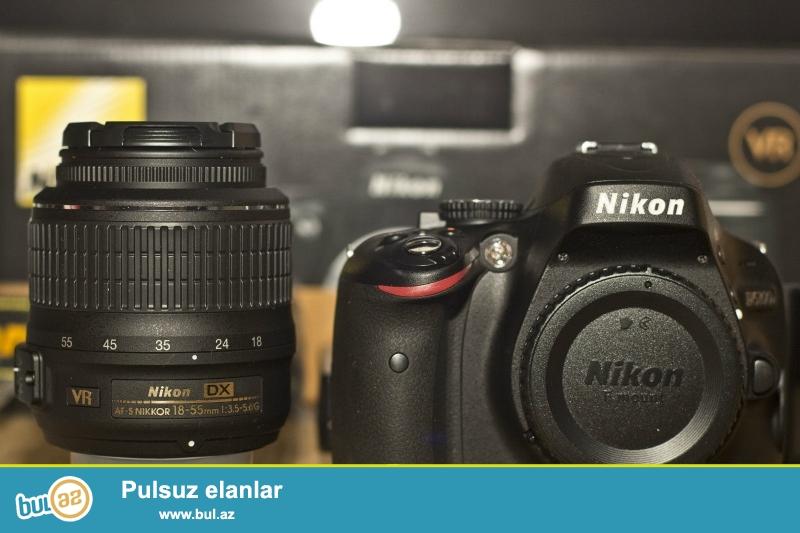 Nikon D5100 Digital SLR 18-55mm Lens<br /> <br /> Xoşbəxt müştərilərin xoşbəxt cəmiyyət edir...