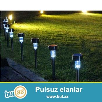 Günəş enerjisi ilə işləyən gece lampalari gündüzler dolur axşamlar işiqlanir