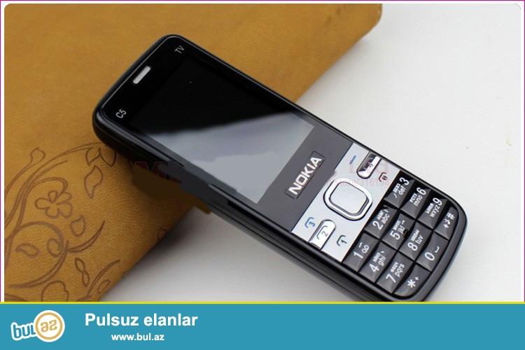 YENI 4 NOMRELI TV FUNKSIALI TELEFON<br /> Əsas Xüsusiyyətlər:<br /> 1) Marka & Model: 206<br /> 2) Stereo kalonka<br /> 3) Yaddaş: 70k<br /> 4) SIM Card sayı: 4 nömrə<br /> 5) Kamera: 1 kamera<br /> 6) Interface: 4xSIM slot, Micro USB, kulaklık 2...