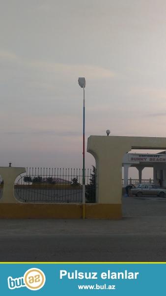 Turkan Qesebesinde asfalt yolun ustunde 20 sot ozume mexsus olan torpaq sahesi satiram...