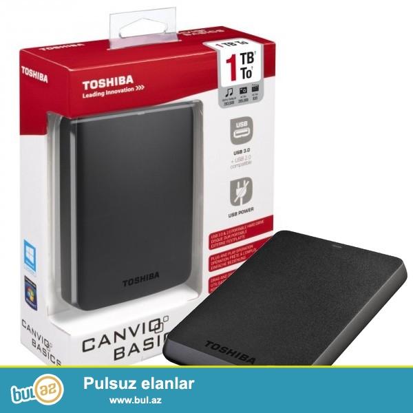 """USB Hard Disk 1TB (kenardan qoshulan)Toshiba Canvio Basics  (yeni)<br /> <br /> <br /> Sheher ichi chatdirilma + 2azn<br /> <br /> Rayonlarada gonderilir<br /> <br /> Elave elanlarimizi gormek uchun """"Istifadecinin butun elanlari"""" -na baxin<br /> <br /> Whatsapp: 050 227 27 55<br /> <br /> Skype: toptan..."""