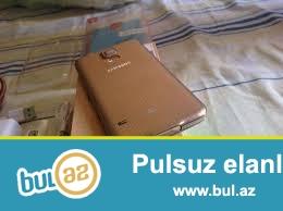Samsung S5 gold qutusu var full telefondur problemsiz