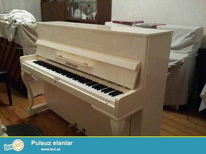 krem rengli shiller  pianinosu almaniyanindir super veziyyetdedir .
