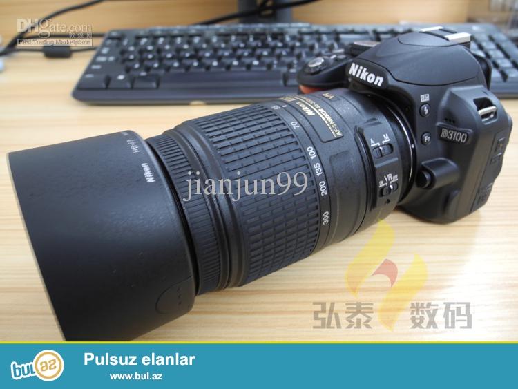 Nikon D3100 55-300 mm obyekiv ile satilir. Ustunde adaptir, 8 GB kart canta verilir. Bir problemi var oda Fotoaparatin ekani 5/1 hissesi catlaqdir...