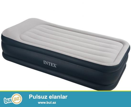 """Надувная кровать модель серии """"Intex Twin Deluxe Pillow Rest Bed"""" кровать сделана по новейшим технологиям имеет удобный подголовник, отличную усовершенствованную конструкцию и несомненно привлекательный внешний вид ..."""