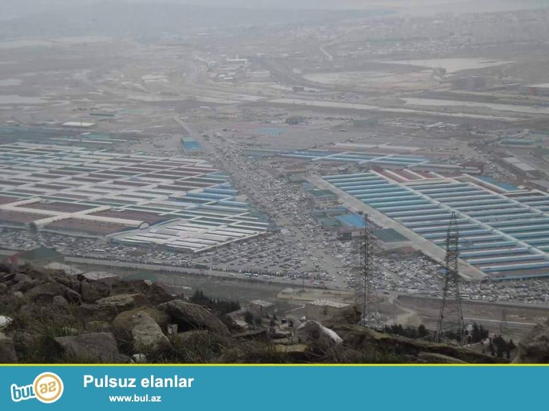 Batandartda,1ci maasivdə,yolun üstündə,1.5 hektar torpaq satılır...
