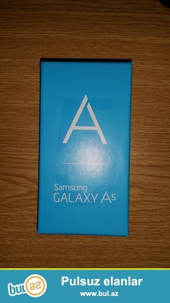 Yeni Samsung Galaxy A5 ishlenmeyib karopkasindadir,butun aksesuarlari ile birlikde 1 il zemanet ile...