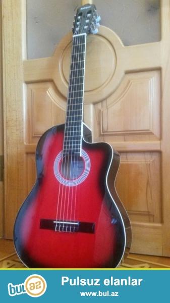 Gitar ela veziyyetdedir 1 ay istifade olunub tam problemsizdir ozunuz gorusub yoxlaya bilersiniz ciddi olmayanlar narahat elemesin isteyen watsappdan yaza biler 0514397070