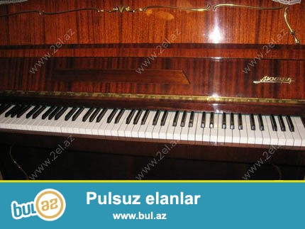 Qəhvəyi rəngli üç pedallı AKKORD  pianinosu əla vəziyyətdə<br /> ünvan Yeni Günəşli