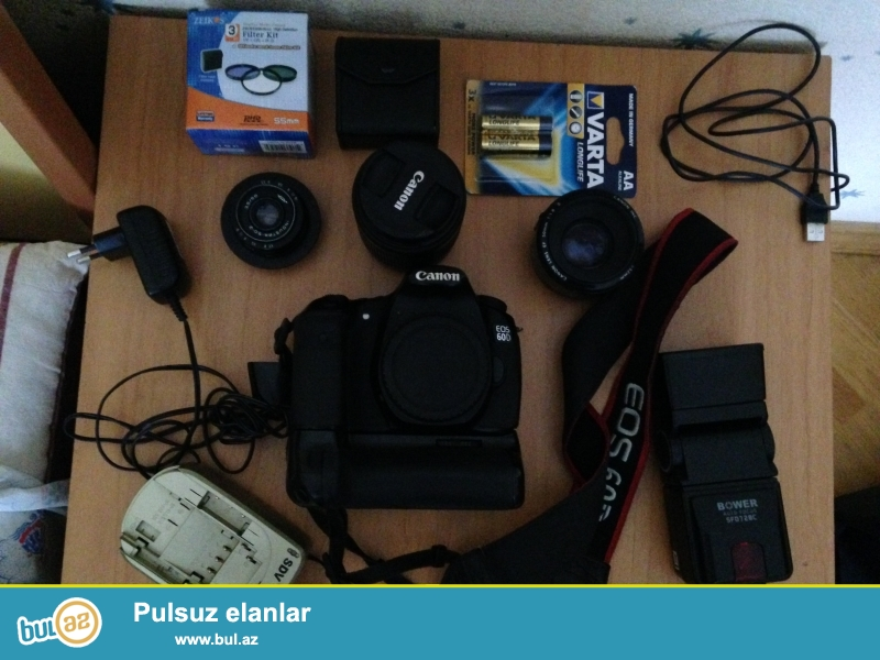 CANON EOS 60D BODY + 18-55 mm lens + 50 mm lens + industrator lens + Bower flash + Orginal grip + sd card + Vanguard orginal chanta + filter kit...