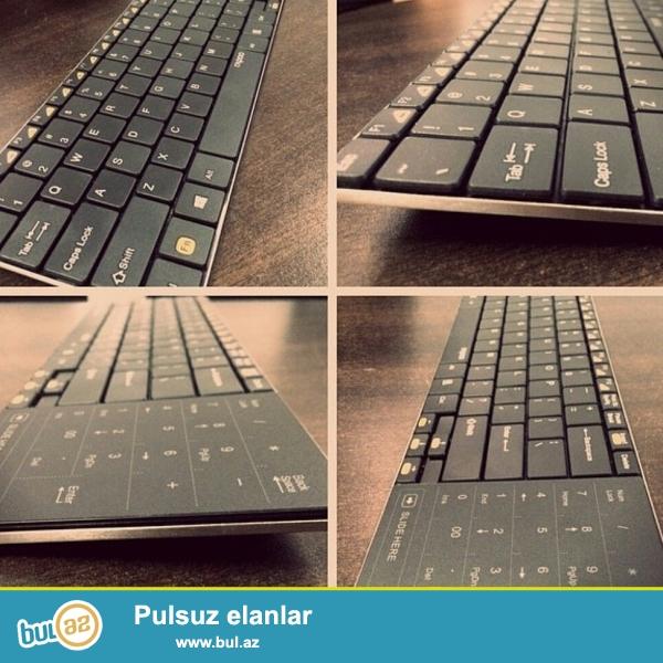 Rapoo - E9080 Wireless Touchpad Keyboard <br /> Ultra slimdi nazik dizayına malikdir mouse və keyboard 2 si birlikdədi mouse notebooklardakı kimidi kənarında yerləşir həm rəqəmsal düymələr var tocscrendi həmdə mouse funksiyasın yerinə yetirir...