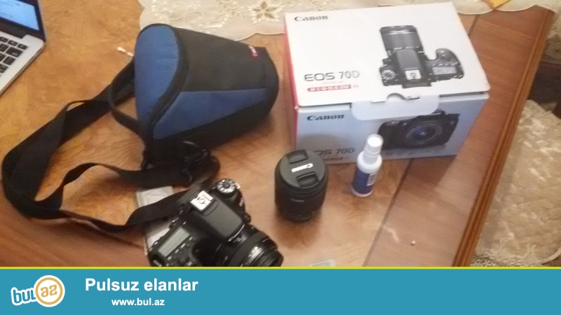 Uzerinde 1.8 55mm ve 50mm 1.4 obyektiv, chantasi ve 8GB, 16GB yaddash karti...