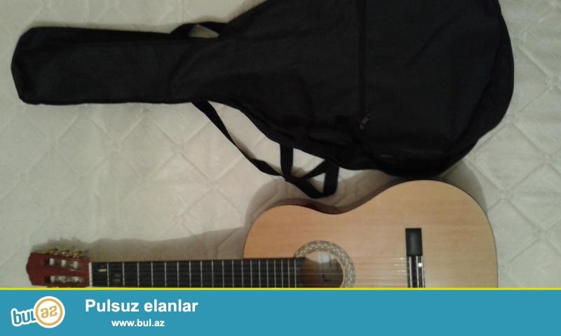Classik Gitaradi(rodriges) 3-4ayin gitarasidir az/maz ciziqi var ama simleri zadi teze deyişilib...