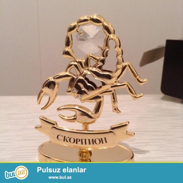 Scorpion wins <br /> Bürc scorpion qizil suna salinmiw metaldi üstünde xrustaldan olan daw qaw var...