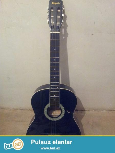 SEGOVIA az iwlenmiw klassik gitara satilir.Gitara Turkiyeden gelmedir...