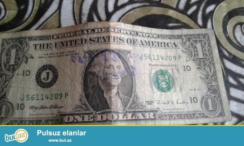 normal veziyetde olan  1 dollardi  21 ilin  eskinasidir ciddi  fikirli  olan insanlar muraciet ede biler