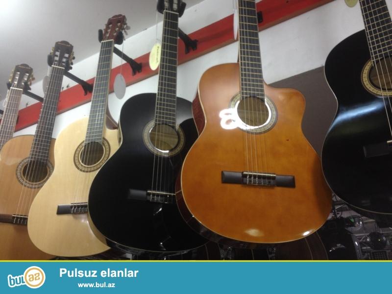 Klassik akustik elektron gitaraları en uyğun qiymet be keyfiyyetde bizden alın...