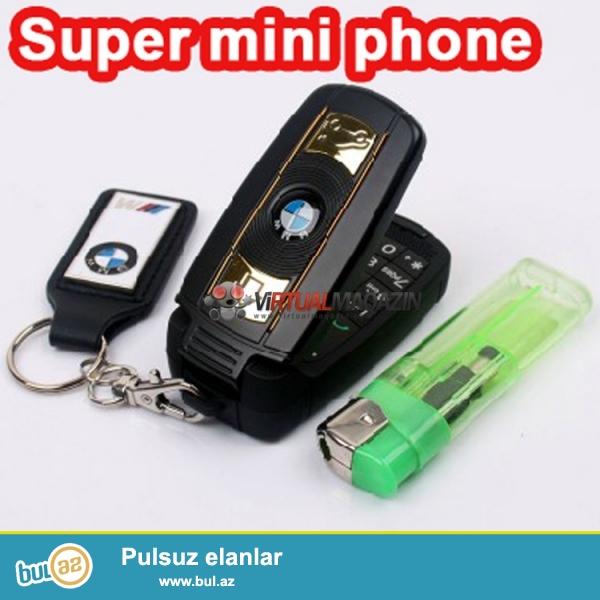 Yeni.Çatdırılma Pulsuz<br /> Bmw x6 Pult boyda mini telefon<br /> <br /> <br />     Qeydiyyat olunub:Beli<br />     Ekran rengi:Rəngli<br />     Dizayn:Flip<br />     Şəbəkə:GSM<br />     Sim kart sayı:1 nömrə<br />     Kamera:Var<br />     Yaddaş:8Gb<br />     Digər funksiyalar:MP3 Player,Bluetooth,Video Player,Message<br />     Yaddaş kartı:Dəstəkləyir<br />     Batareya növü:Çıxarılabilən<br />     Yerində satış vəziyyəti:Yeni<br />     Batareya tutumu(mAh):800mAh<br />     Dillər:English,Russian,German,French,Spanish,Portuguese,Italian,Turkish,Arabic,Greek,myanmar,Thai,Persian,Vietnamese<br />     Ölçüsü:66*33*10mm<br />     Brand adı:Bmw<br />     Ekran ölçüsü:1...