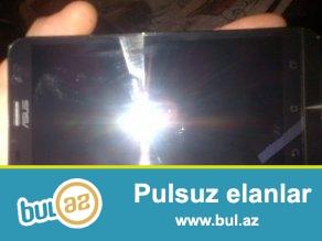 tecili satiram ASUS zenfone 2 ze551ml <br /> 4GB ram oz yaddasi 64GB <br /> elave yaddas 64GB gedir <br /> 2 nomreli <br /> iki aydi isledirem hecbir problemi yoxdu, senedi herseyi var <br /> 2 ilzemaneti var<br /> barter ancag iphone 5s le