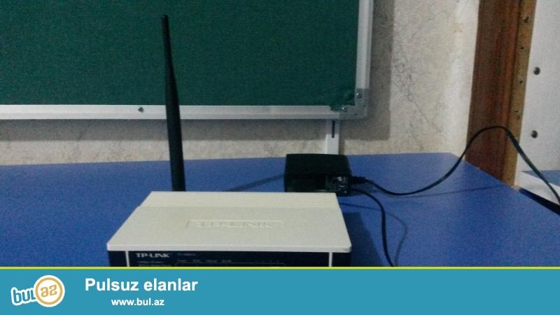 Tplink modem 4port WIFI.   Az islenmish arxasindaki kagiz bele cixmayib...