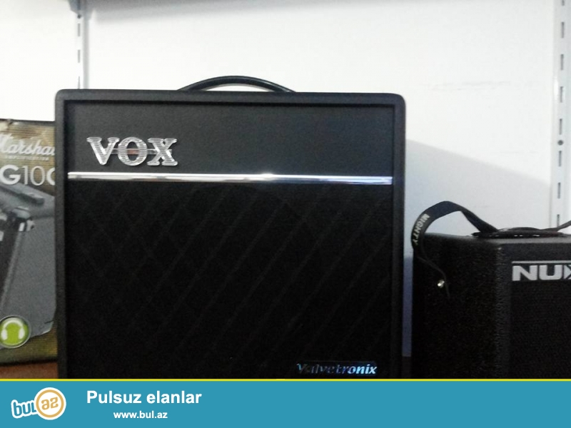 """Elektro gitar ucun profesional lamp amfi.<br /> <br /> * Power amp output: 60W RMS (@ 8 ohms) <br /> * Speaker: 1 x 10"""" VOX original speaker <br /> * Power level control can limit the power amp output wattage, creating distinctive power amp distortion at any listening level <br /> * Tube-driven VOX Valve Reactor circuit uses a 12 AX7 vacuum tube for true-tube tone <br /> * Number of amp models: 33 <br /> * Number of effects: 11 pedal effect types, 3 reverb types, 1 noise reduction type <br /> * Number of programs: 99 preset, 8 user (2 banks x 4 channels) <br /> * Built-in automatic guitar tuner <br /> * Input/output jacks <br /> * Top panel: Input jack (1/4"""" Mono) <br /> 1/8"""" headphone output simulates the acoustic and spatial character of a full speaker cabinet <br /> * Aux IN jack (1/8"""" Stereo) <br /> * Rear panel: Foot SW jack <br /> * Power supply requirements: AC, local voltage <br /> * Power consumption: 36W <br /> * Dimensions: 16..."""