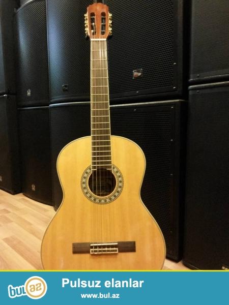 Manuel Ortega markali eklvalazerli klassik gitar. 2ci el olsada yep yeni kimidir...