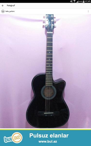 Akustik gitara.ela gitaradir.cxholnan 90 azn,cxholsuz 80 azn,ustunde elave simler verirem.