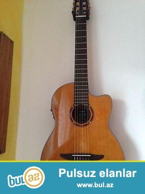 Ideal  veziyyetde cızıqsız, zedesiz tam orijinal professional Yamaha NCX 700C model electroklassik gitara...
