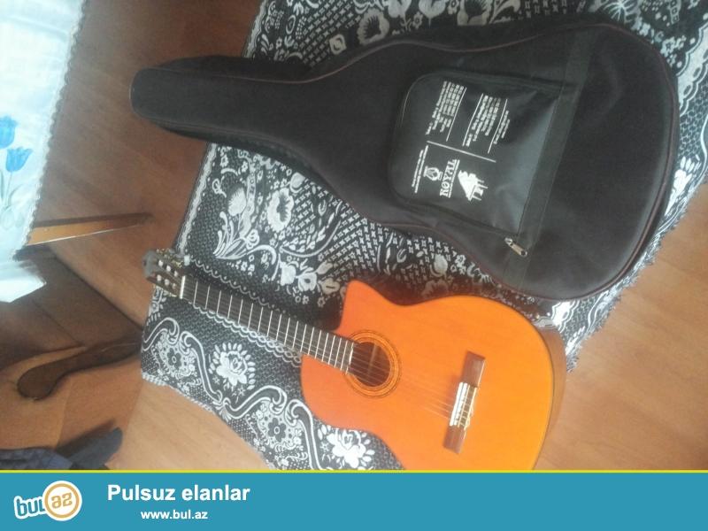 klassik gitara wasburn satiram.teze almisam 2 ay olar...