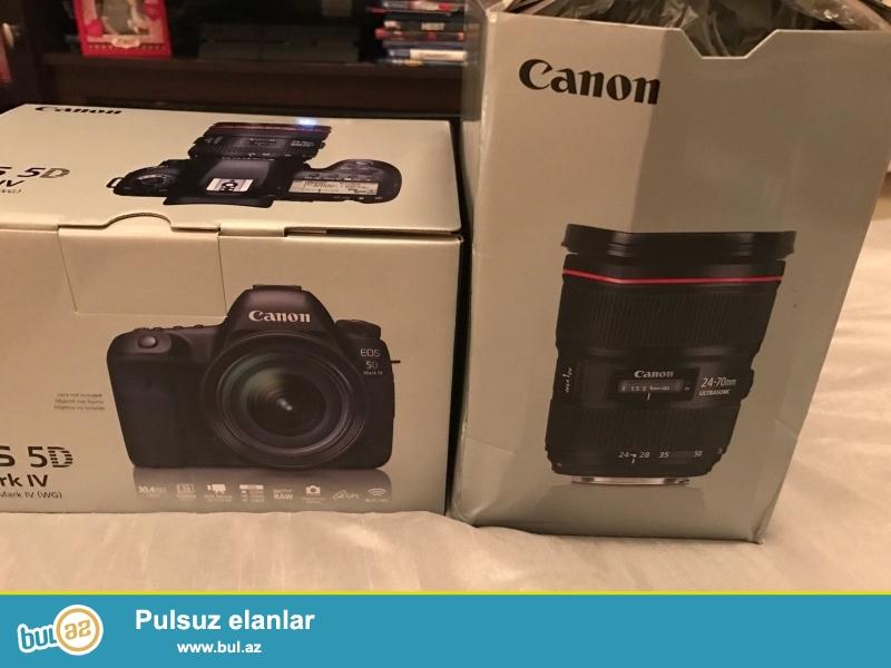 <br /> Canon EOS 5D Mark IV Body<br /> Canon EF24-105mm F4L II USM Zoom Lens IS<br />  Canon LP-E6N Lithium Ion Battery Pack<br /> Canon Battery Charger LP-E6<br /> Canon Eyecup Məsələn (göstərilməyib)<br /> Canon Wide Askı<br /> Canon Cable Protector<br /> Canon Interface Cable IFC-150U II<br /> Canon EOS DIGITAL Solution Disk<br /> Canon 1 il hissələri və əmək ABŞ Zəmanət...