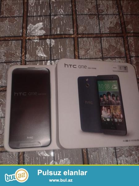 Yeni HTC One E8, duosdir. Parametrleri HTC One M8 le eynidir...