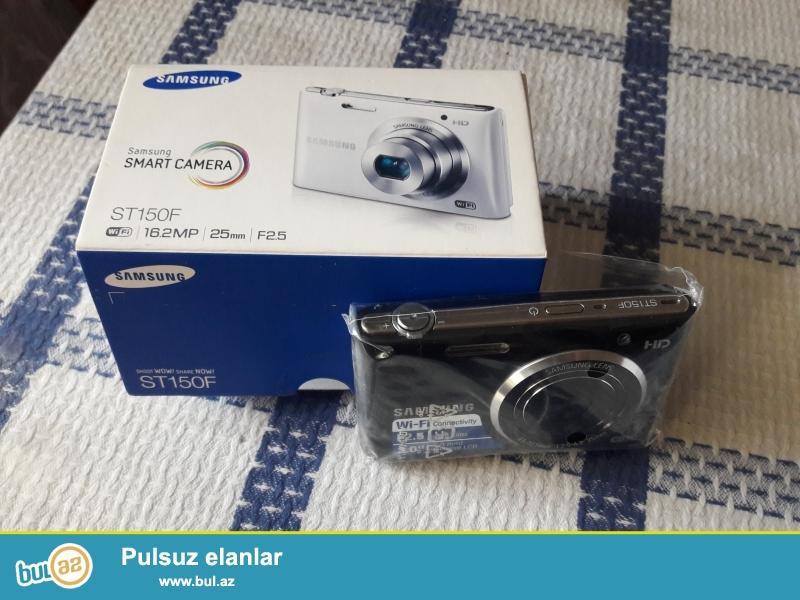 Fotoaparat yenidir, koropkadan chixmayib, butun aksesuarlari uzerindedir (adapter, oz batareyasi, USB shunur)...