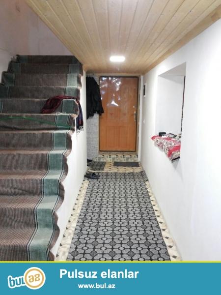 Novxanı Qəsəbəsində 4sot torpa2 sahəsində 2 mərtəbəli ümumi sahəsi 220kv metr həyət evi satılır...